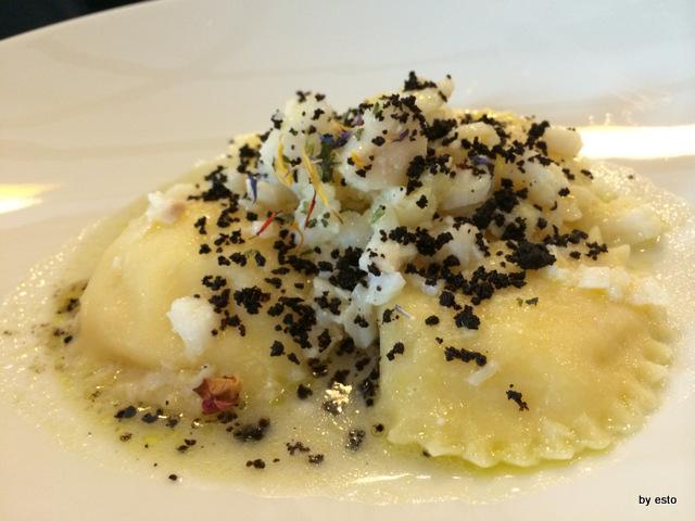 Ravioli di patata e provola, baccala' e polvere di olive nere