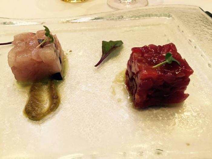 Gambero Rosso, tartare di tonno e palamito con pomodorini in salsa di cipolla rosso di Tropea e Tartare di Ricciola, olive nere, pesto di capperi