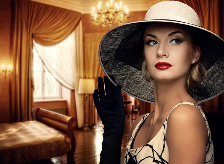 Beautiful woman wearing hat in luxury room.