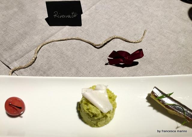 Pane burro e alici, spugna di piselli con lardo e foie gras avvolto in cioccolato bianco caramellato
