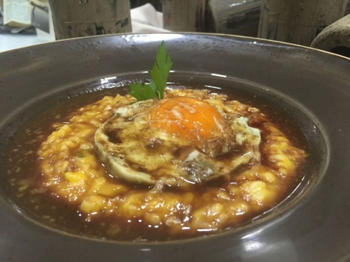 Risotto con zucca lunga, uova, conciato romano e Solopaca