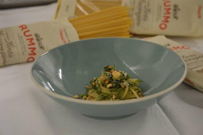 Spaghetti con colatura di alici di Cetara, nocciola Tonda di Giffoni ed erbette del Monte Stella