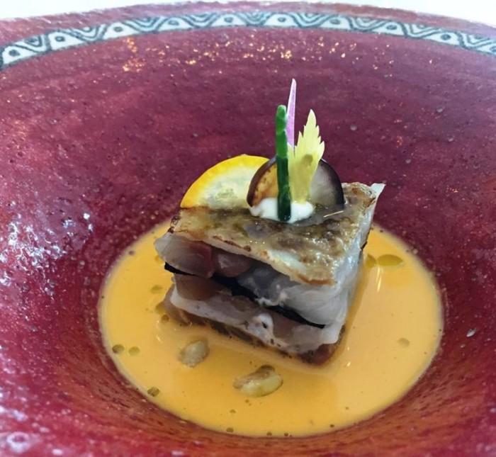 Torre del Saracino, millefoglie di seppia e sauro, su salsa di carota, sedano pomodoro giallo e noci