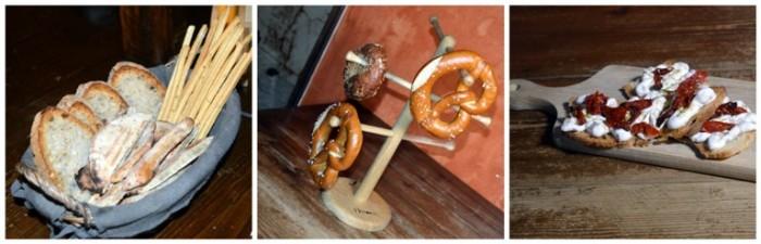 Historia Birreria, l'ingresso, il cestino del pane, brezel e bagel e bruschette con mousse di ricotta di bufala e porcini, pomodori semi-dry e finocchietto