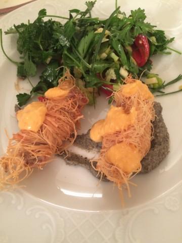 Kadaif wrapped fish in lemon sauce on eggplant cream and green salad