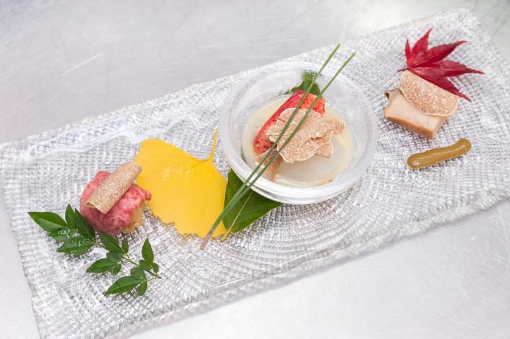 Wagyu Beef Sushi. brasied abalone liver sauce, lobster white miso sauce, Alba white truffle