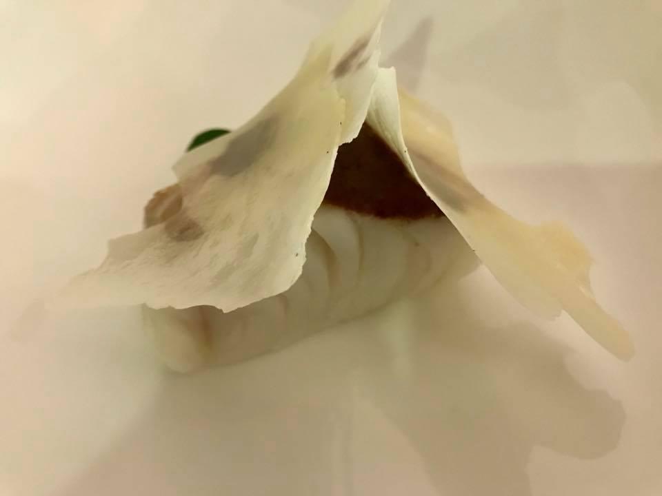 Taverna Estia, mussillo di Baccala' cotto in olio evo, pomata di olive Itrane, latte di bufala croccante leggermente affumicato