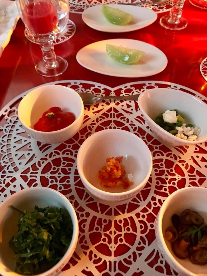 Pasha', aperitivo. Burrata e rucola, panzanella, asparagi e maionese, parigiana morbida, funghi e nervetti, croccate all'acciuga, cocomero, succo di pomodor, Campari e tabasco
