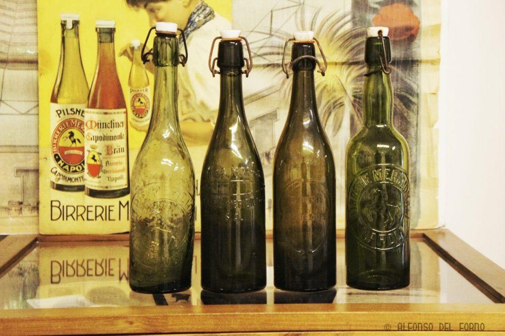 Bottiglie e manifesto di Birrerie Meridionali