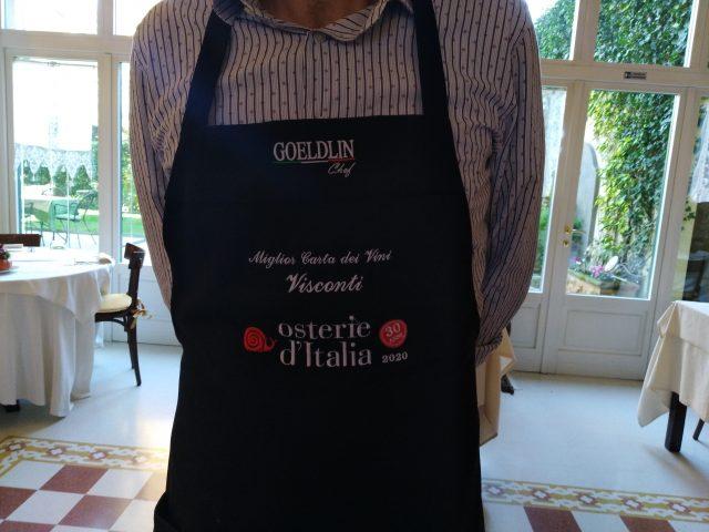 Daniele Caccia col grembiule di Migliore carta de vini e chiocciola Slow Food