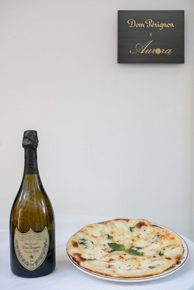 Dom Perignon e pizza all'acqua