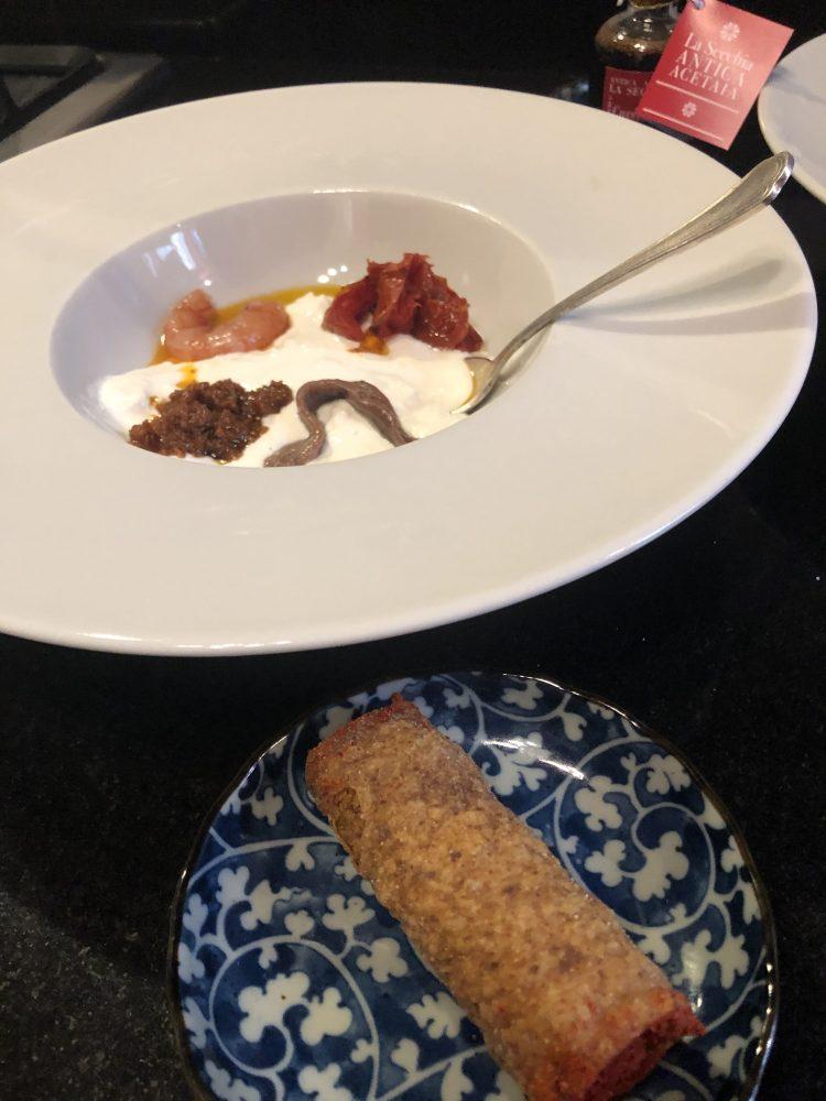 Burrata e cannolo di pane ripieno di baccala' mantecato- Rimessa Roscioli Roma